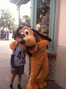 "Pluto, giving my son a hug because he has such a ""wicked witch"" of a mother!"