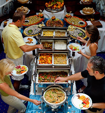 That blonde in the lower left is about to get her fingers slammed in the chafing dish lid. Not just chaffed, SLAMMED!